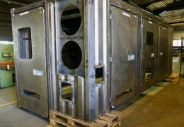 Container housing for compressors for the oil and gas industry
